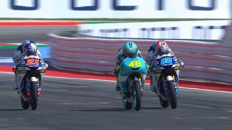 Dalla Porta (centre) out-drags Jorge Martin (right) to the finish line. 23be533cb